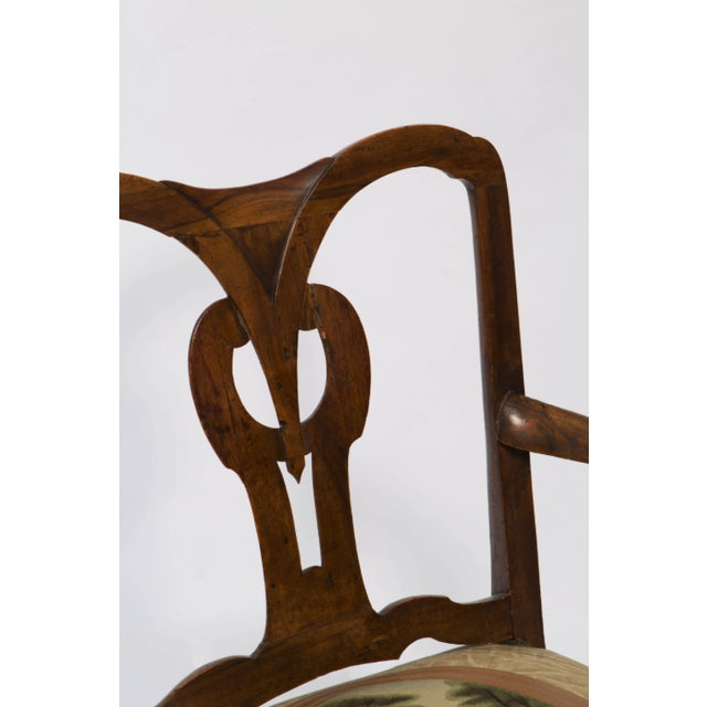18th century Italian armchair has a beautiful open back with center design back. It is a walnut chair with open-arms and...