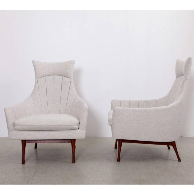 Rare pair of Paul McCobb high back Symmetric Group lounge chairs for Widdicomb with new light grey Romo fabric. Overall...
