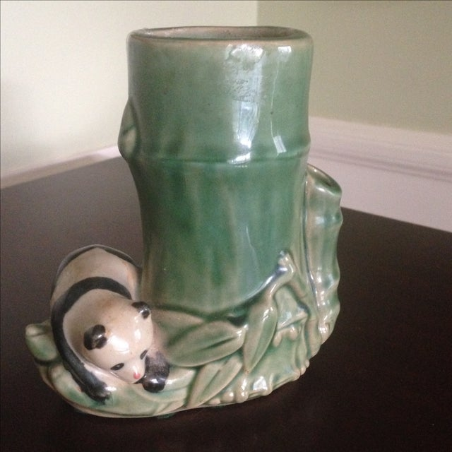 A Mid-Century style faux bamboo vase. This vintage piece is in green, glazed ceramic. It features a faux bamboo center,...