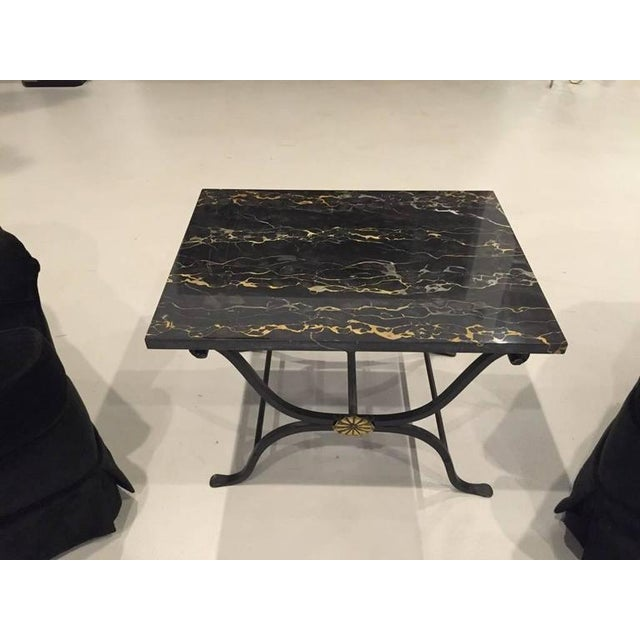 "This 1930s French Art Deco wrought iron occasional or coffee table has a rare old Portoro marble top with ""heartbeat""..."