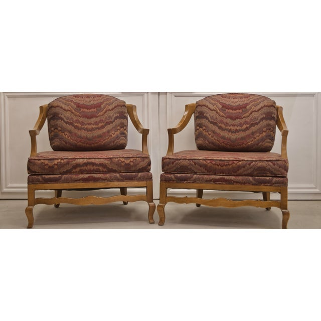 Pair of amazing flame low profile wood chairs with a wide back, gently sloping sides, and simple ornate legs. This...