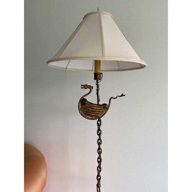 This is a studio-made one-of-a-kind tall bronze or steel (it's heavy!) lamp with a viking whimsy theme. Rewired. Switch...