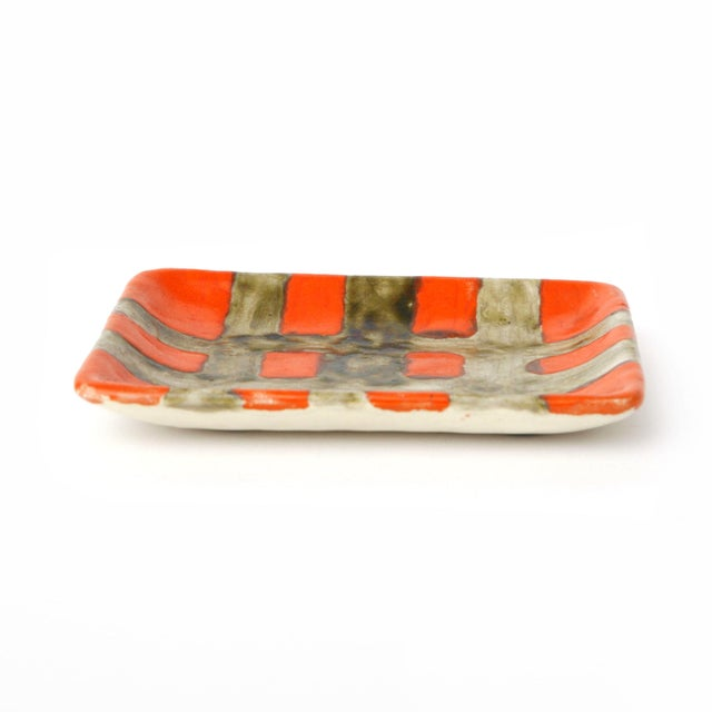 """Vibrant orange and washed black ceramic dish by Gambone. Signed """"Gambone Italy"""" and felt pads on underside."""
