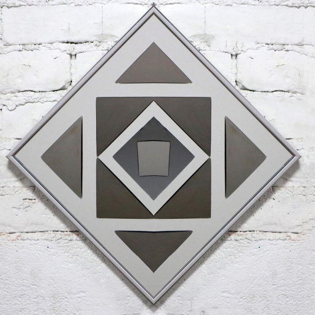 Extraordinary trio of Pop Art or Op Art framed mirror wall sculptures by Hal Bienenfeld. This set of three gray and silver...