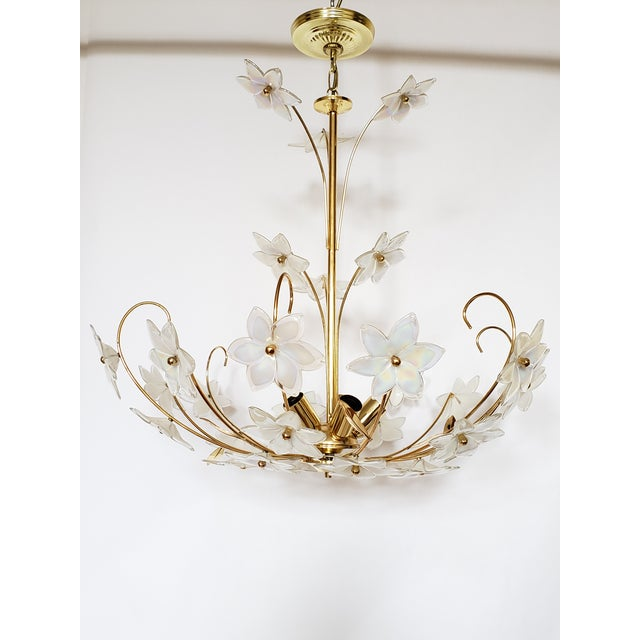 Gorgeous Italian floral motif chandelier made of Murano glass flowers and gilt leaves. It will always be spring in your...