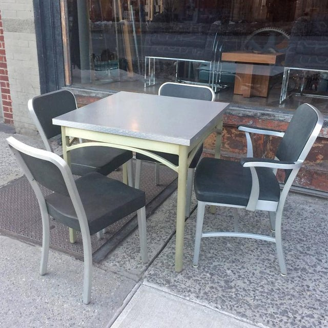 Mid-century, brushed aluminum, dining or kitchen set by GoodForm, The General Fireproofing Co. features a square table...