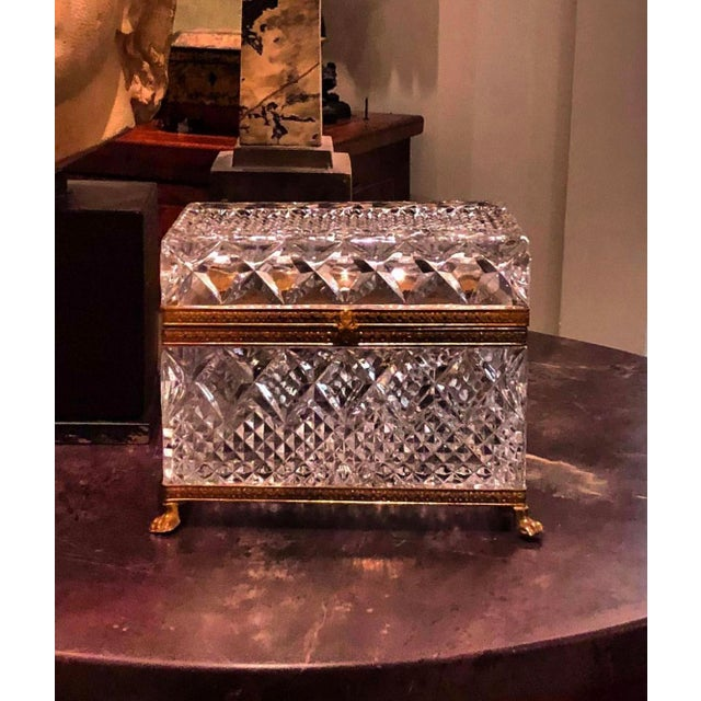A beautiful cut and press crystal box from France. The French crystal box has bronze doré mounts. It is on little tiger...