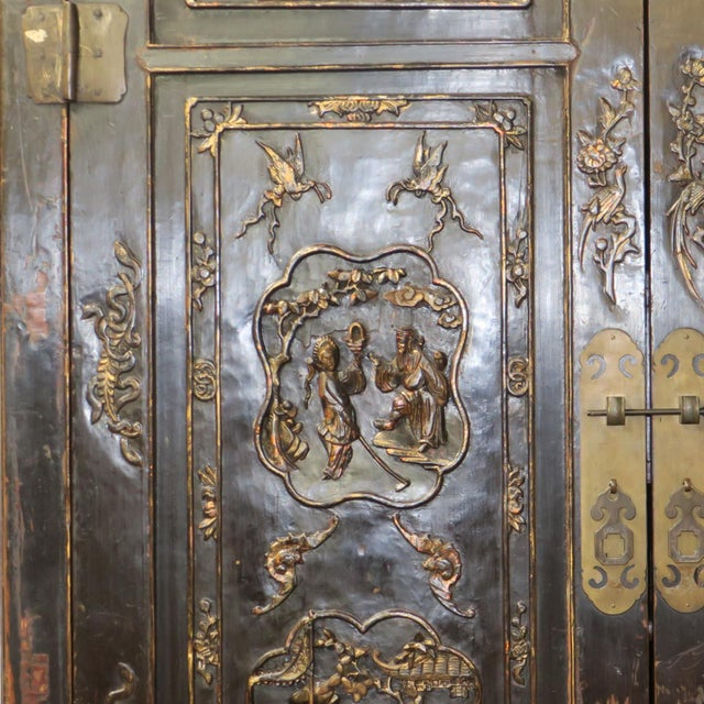 Antique Chinese Black Wedding Wardrobe Cabinet With Gold Carvings For Sale In Charlotte - Image 6 of 12