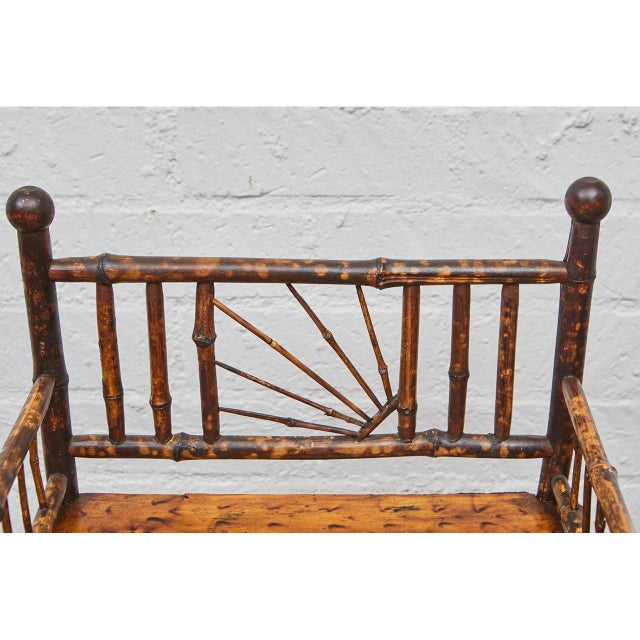 These English Victorian tiger bamboo shelves are beautifully designed and executed. The sides and back of the piece are...