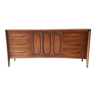 Broyhill Emphasis Mid-Century Modern Sculpted Walnut Credenza or Triple Dresser For Sale