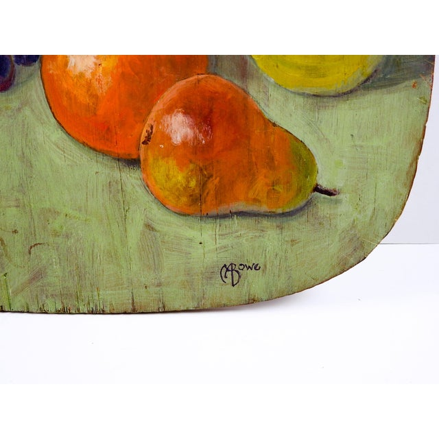 Circa 1960's oil on wood panel still life with fruit. Signed M A Bowe lower right corner. Wood is cut with rounded...