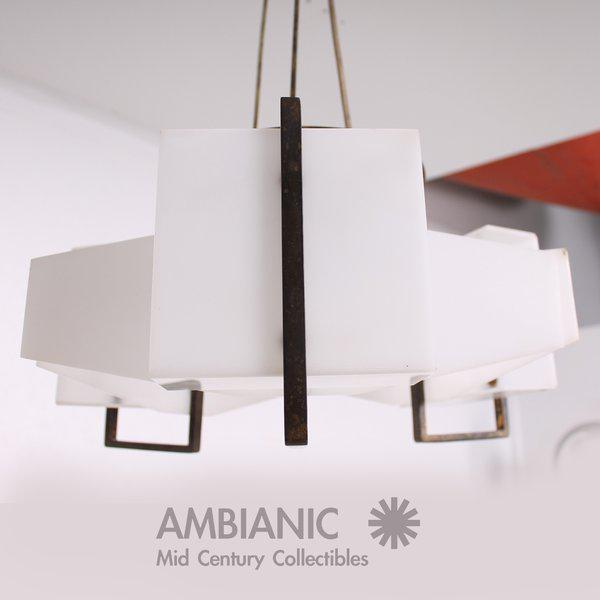 For your consideration a vintage modern chandelier made in Italy. Constructed with brass and plexiglass in white color....
