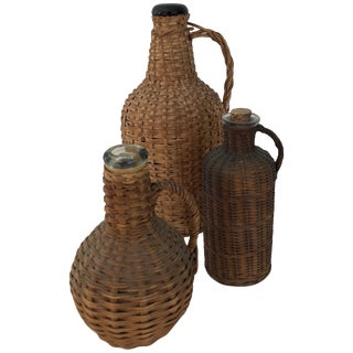 Three Vintage Wicker Wrapped Jugs For Sale