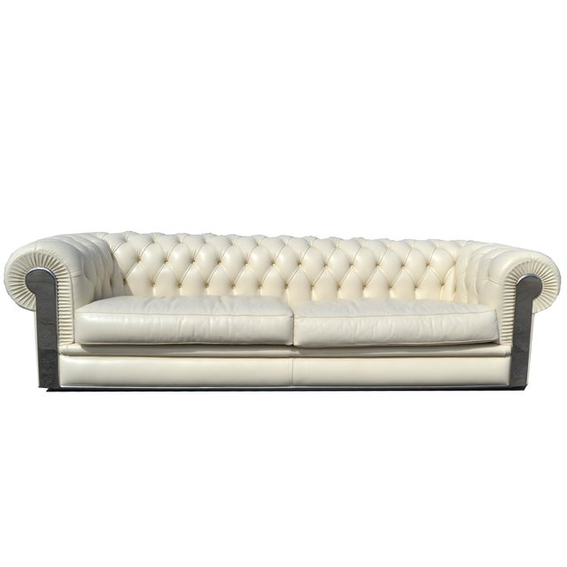 Original Fendi tufted Albino leather sofa in Chesterfield style. The arms have chrome inlays and it comes with two...