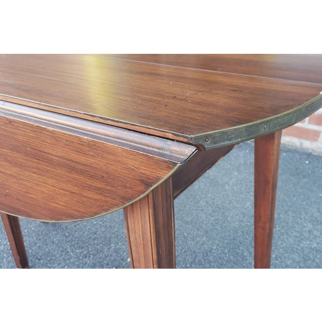 20th Century Mahogany Regency Style Brass Edge Drop Leaf Dining Room Table W/ 4 Leaves C1950 For Sale - Image 4 of 13