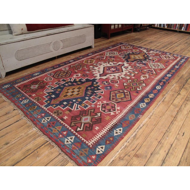 An old tribal kilim from the Caucasus with somewhat unusual design.