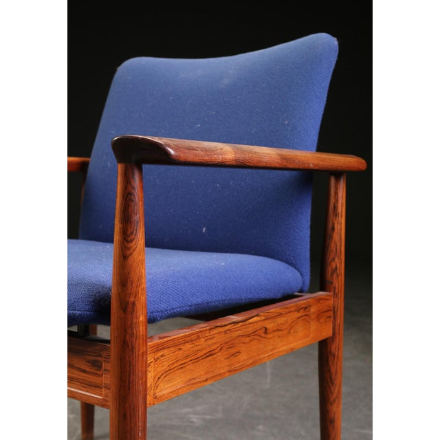Finn Juhl, diplomat desk chair or armchair with frame in solid hardwood, model 209. Designed in 1963. Produced by France &...