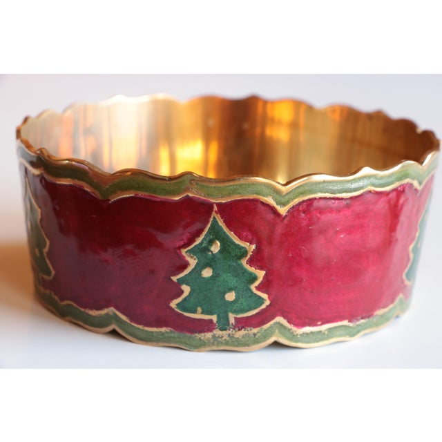 Vintage brass champagne coaster with a scalloped rim and wraparound burgundy red and green enameled Christmas tree...