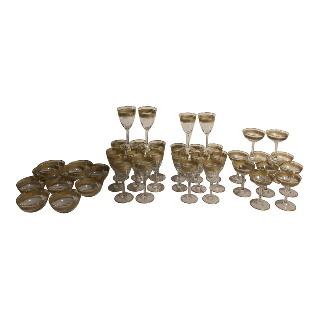Mid 20th Century Baccarat French Gilt Crystal Directoire Style Glassware - Set of 40 For Sale