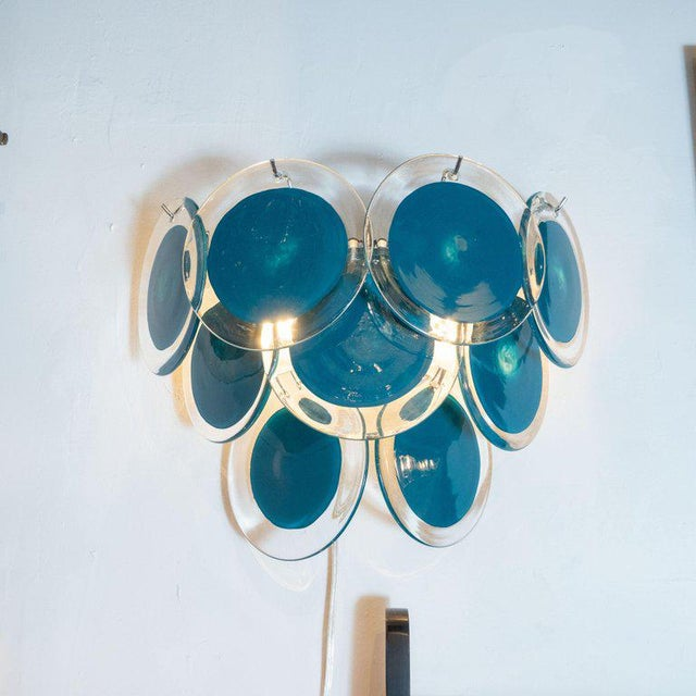 This beautiful pair of modernist 9-disc Vistosi sconces were made exclusively for high style deco by our atelier in...
