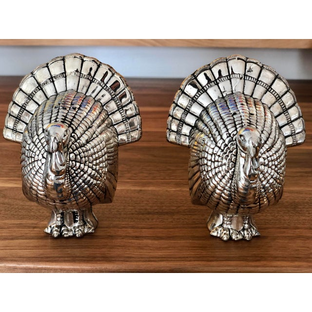 A pair of silver plate salt & pepper shakers in the shape of turkeys. Vintage but unused and in original packaging....