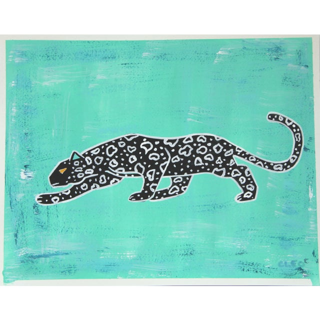 Crouching black and white abstract leopard or cheetah set on a bright textured mint green background. Tropical and playful...