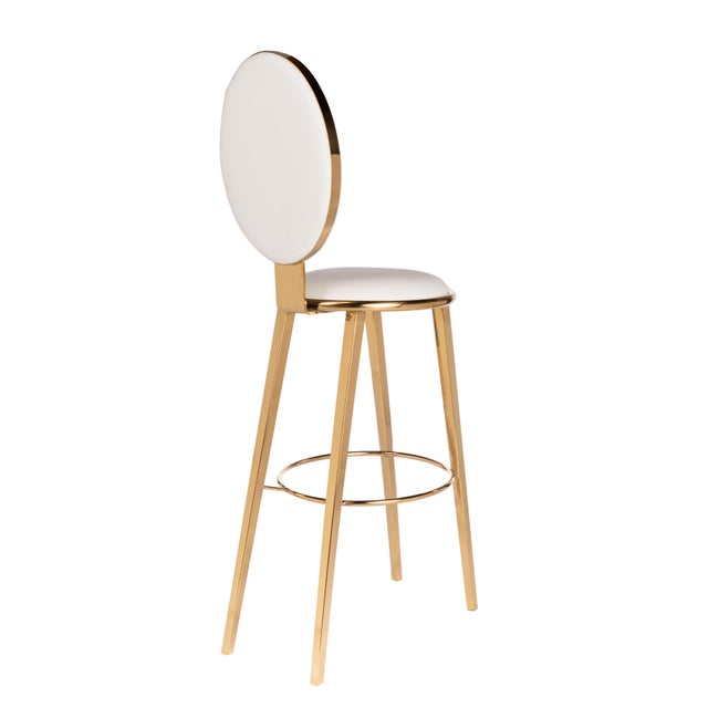 Modern bar stool upholstered in white faux leather seat.Materials: Stainless steel, faux leather.Color: Gold, white.Seat...