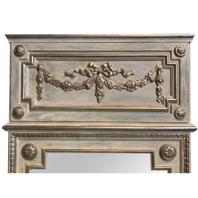 This French style hall mirror features a 2-toned cornice accented with a floral carving and finished in a chipped paint...