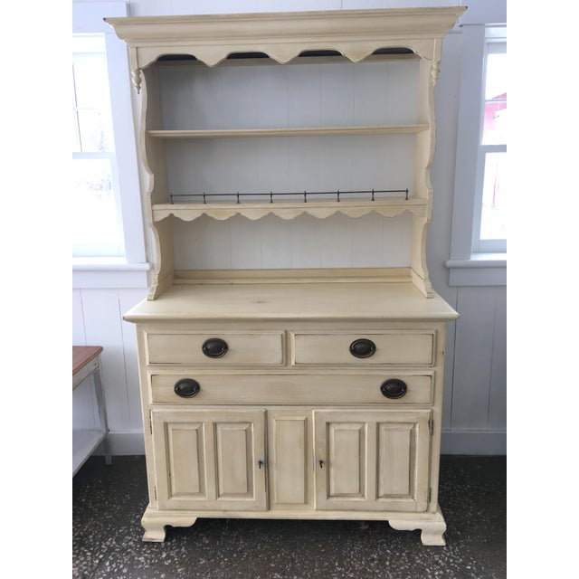 Solid cherry vintage Ethan Allen china and buffet. Pale yellow milk paint finish with light distressing and waxed smooth....