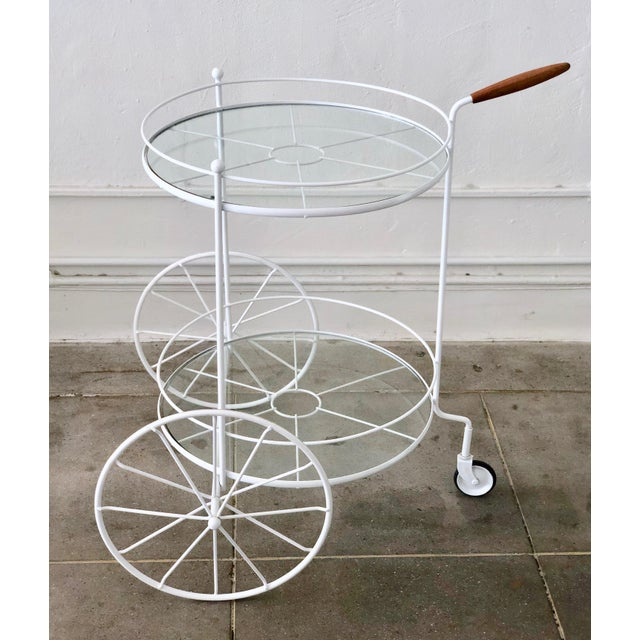 A charming bar cart that is equally at home indoors or outdoors on the patio. This vintage trolley has 2 front large...