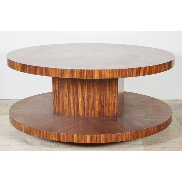 Modernist coffee table in zebrawood veneer with rotating top. The finish is rich and luminous and features a radial veneer...