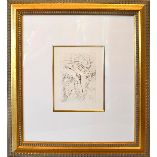 Framed Style after Salvador Dali Etching Titled Melting Clock. The Artwork comes with a gorgeous golden wooden frame....
