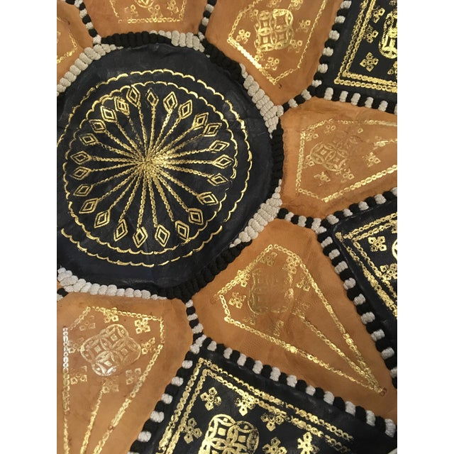 An authentic Moroccan hand-made leather pouf which is made out of genuine soft leather. This pouf is wildly useful - it...