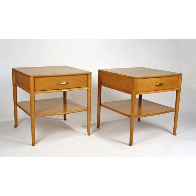 An early pair of nightstands / side tables designed by T. H. Robsjohn Gibbings for Widdicomb with bleached walnut and the...