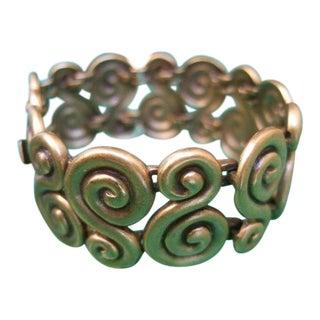 Yves Saint Laurent Gilt Matte Metal Scrolled Link Bracelet For Sale