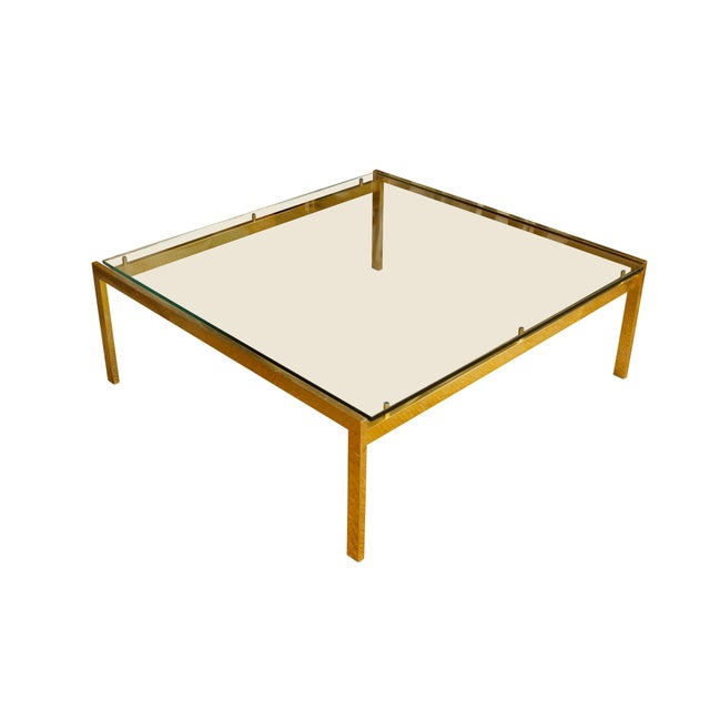 """Large modern brass and glass cocktail table with a 42"""" square glass top."""