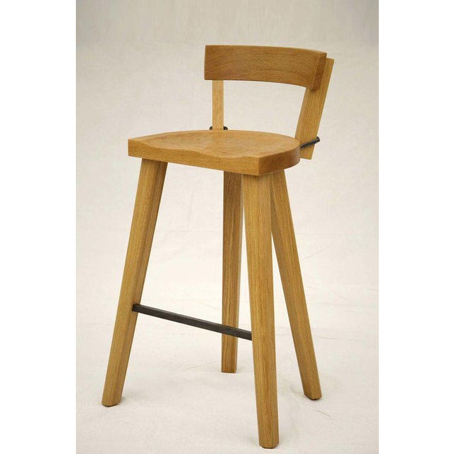 """Designed by Furniture Marolles. Shown in American White Oak and Forged Steel. 4 Legs. Shown at 21.5"""" W x 18.5"""" D x 33"""" H;..."""