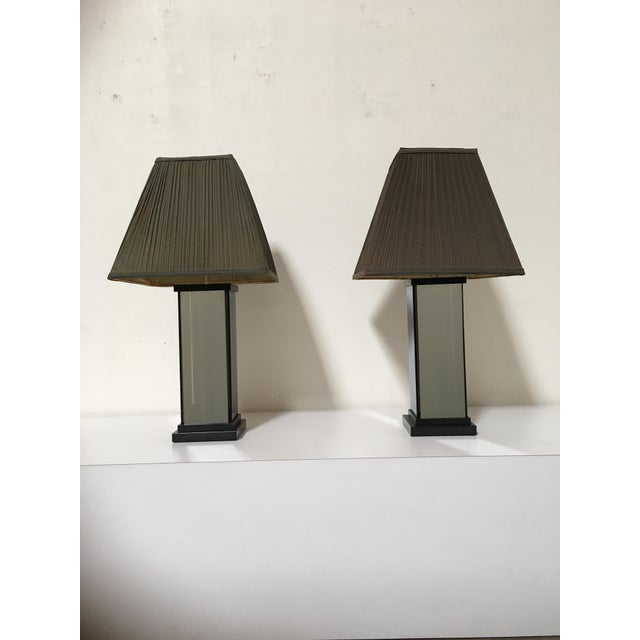 This pair of lamps have a mirror look when not lighted and then when you turn the lights on they have a smokey look