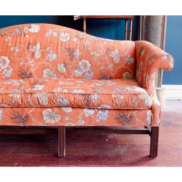 Stunning vintage Baker Sofa in orange Chinoiserie upholstery. Classic styling, Chippendale style legs, rolled arms and...