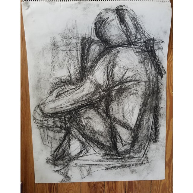 This charcoal on paper drawing of a sitting figure is part of a collection of art that I found; unfortunately, unsigned...