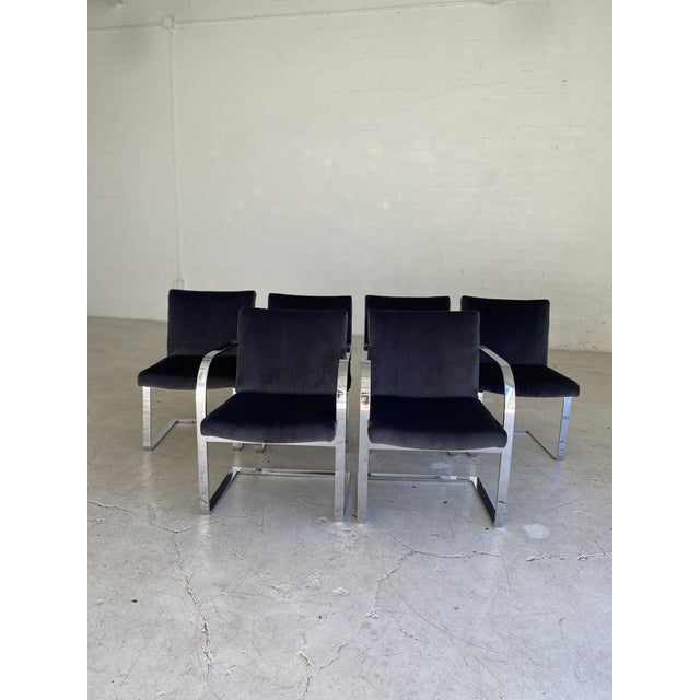 Gorgeous smoky gray velvet and chrome cantilever dining chairs. Two end chairs include arms. Heavy and extremely...