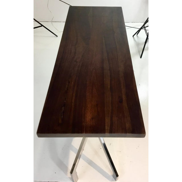 Unique modern dark wood and chrome abstract double pedestal console table, showroom floor sample