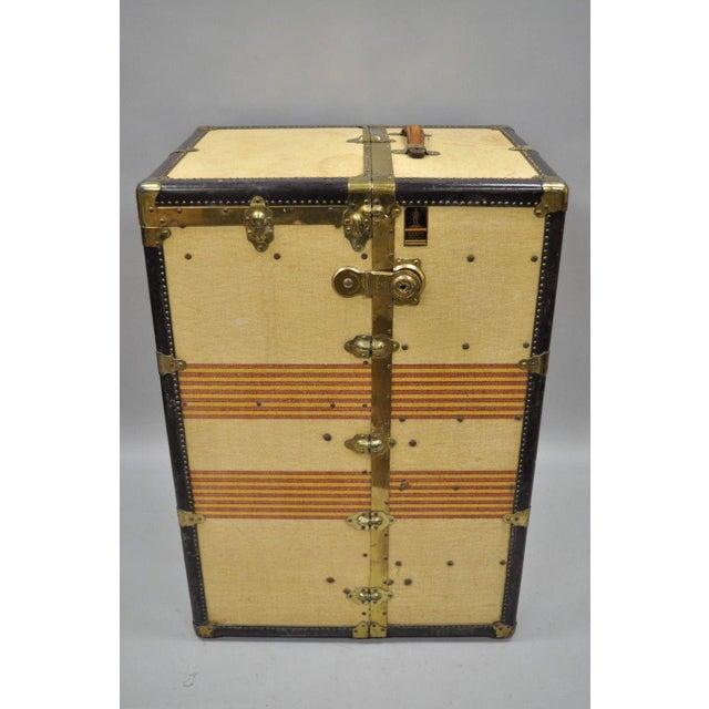 Antique Oshkosh The Chief steamer trunk wardrobe chest. Item features full wardrobe interior, original wrapped ironing...