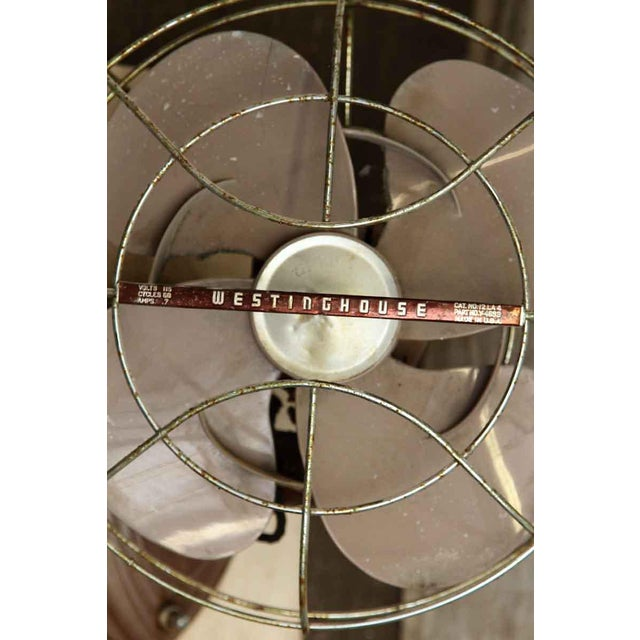 A industrial Westinghouse wall mount fan. Volts 115. Cat. No 12LA4. Made in USA. Salvaged from a hospital.