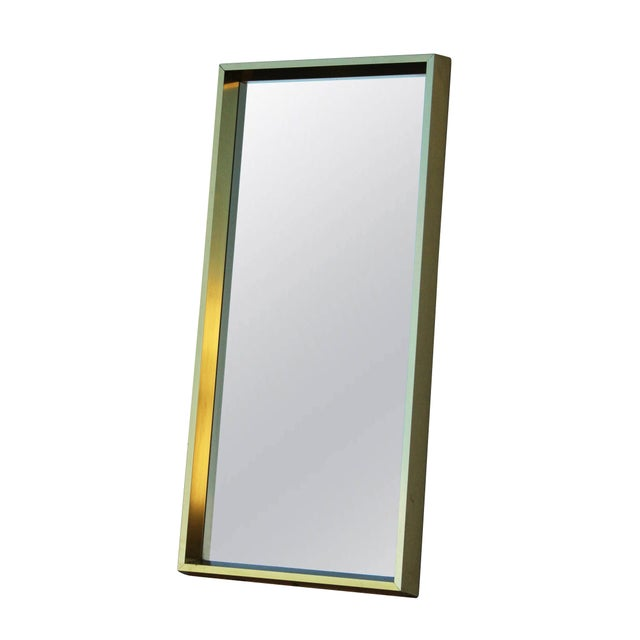 Rectangular Goldtone Mirror in a great proportion. The frame is in extruded aluminum anodized to a brassy goldtone. Marked...