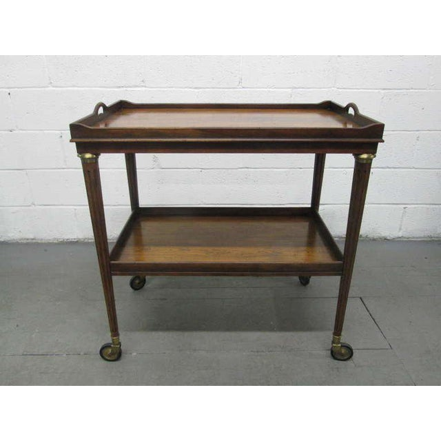 Rosewood and brass two-tier bar cart. Trolley Cart has two extension side leaves with laminated tops.