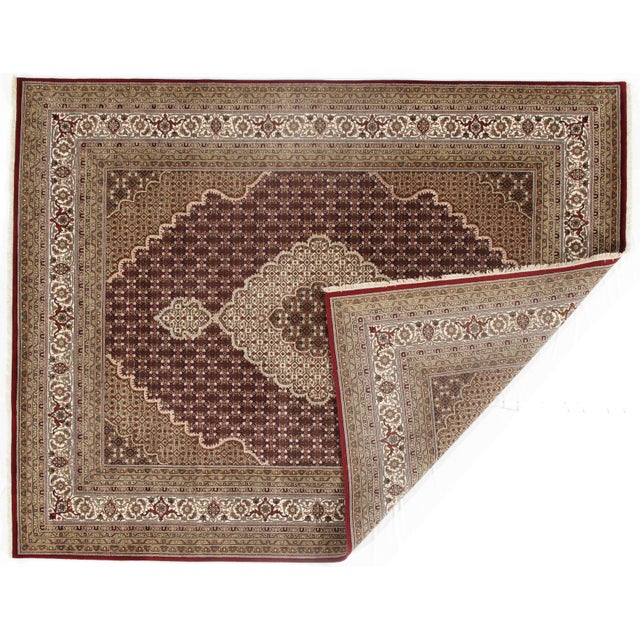 This is a hand-knotted TABRIZ Design Rug. Silk & Hand-Spun Wool Rug. All natural Dyed. This rug is handmade from 100%...