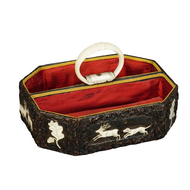 a nice antique black forest basket with handcarved horn plaques on each side representing hunting scenes and oak leaves....
