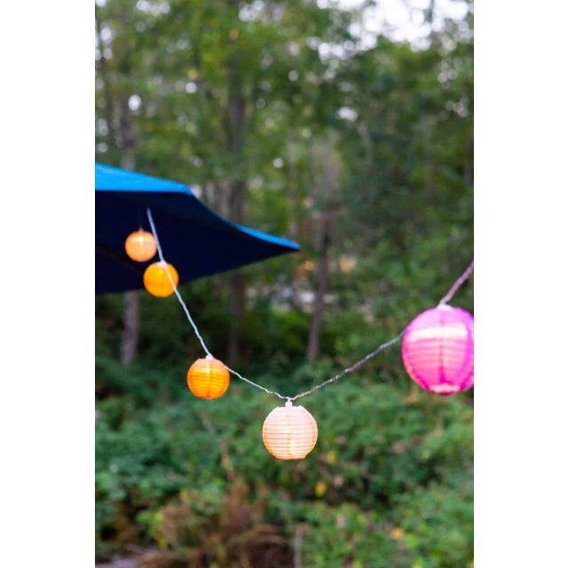 Glow Outdoor Solar String Lights in Peach Bellini For Sale - Image 6 of 9