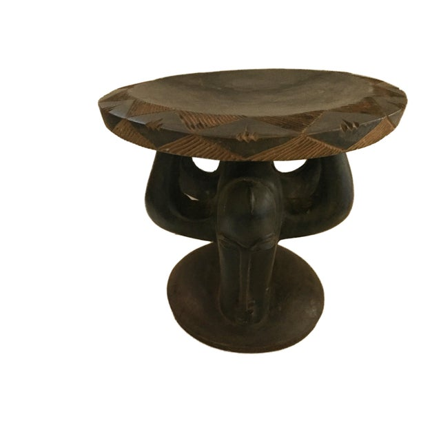 Superb hand carved of one piece of dense heavy wood low stool with faces by the tribe of Baga Guinesa-Bissau ,Stools are a...